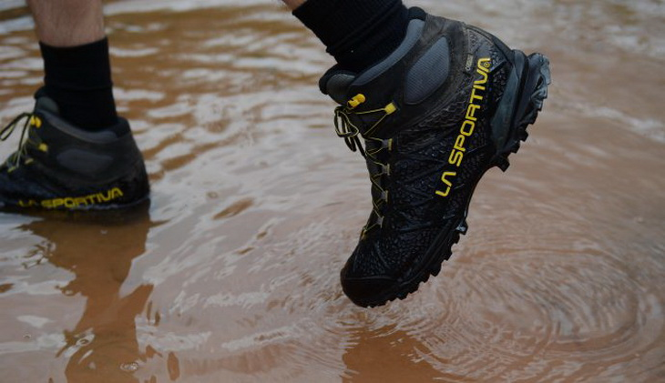 A man wearing a pair of waterproof boots La Sportiva hiking boots