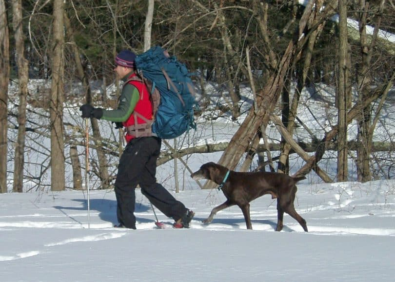 Man with winter backpack