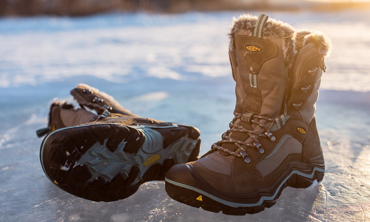 A pair of woman hiking boots on ice