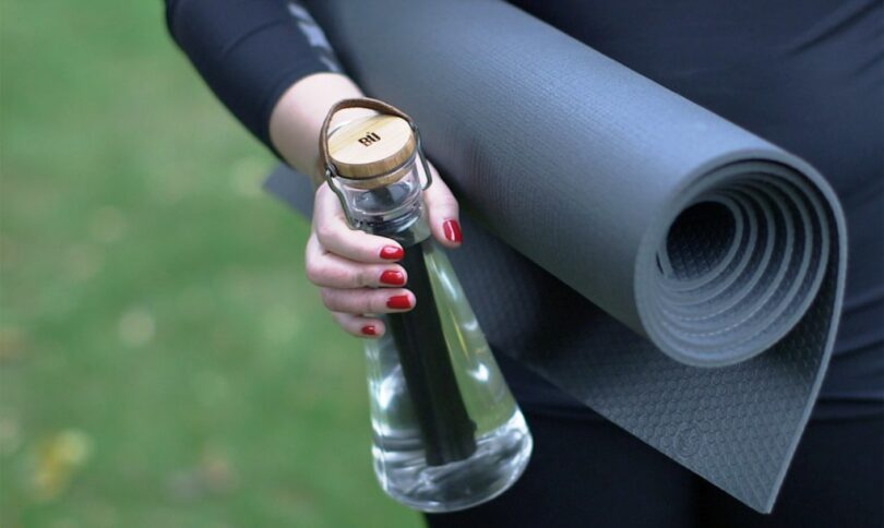 yoga girl holding a water bottle with filter