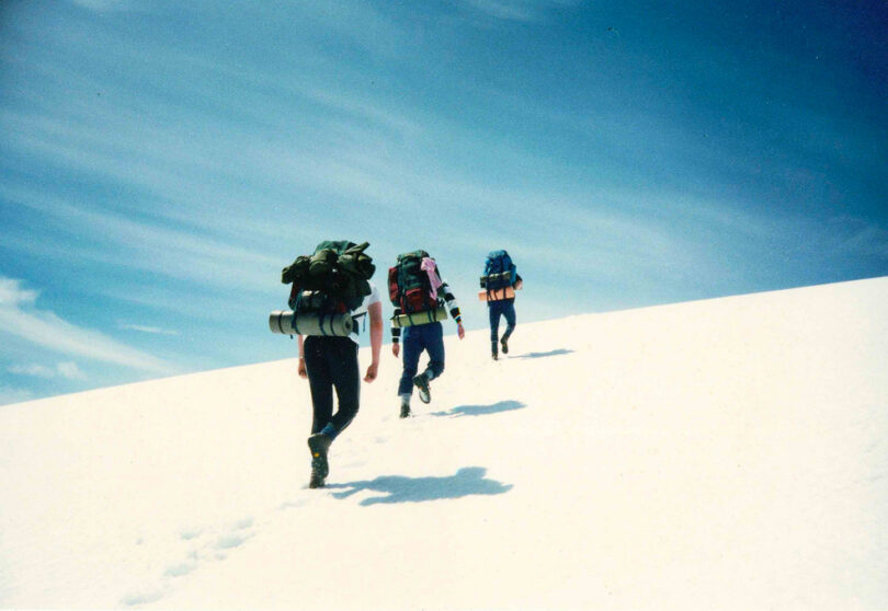 group of 3 hiking in the winter