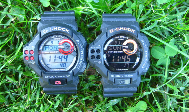 Two ABC watches laying on theg grass