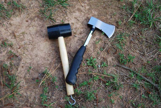 camping hatchet next to sledge hammer