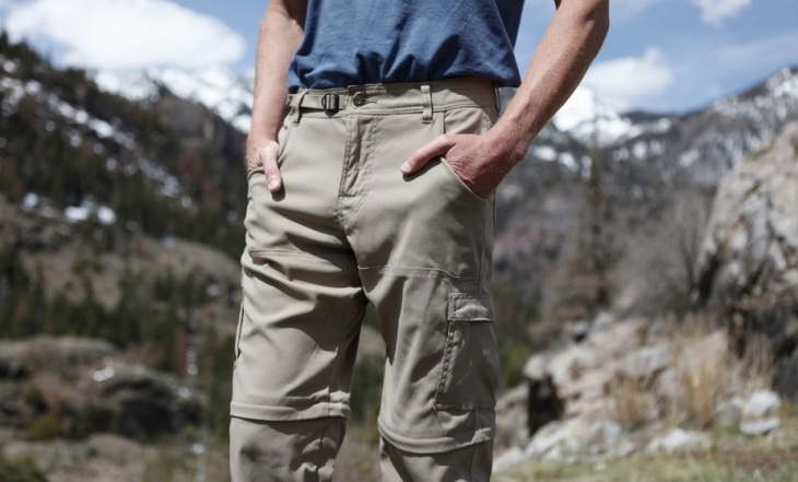 A man presenting a pair of convertibile hiking pants