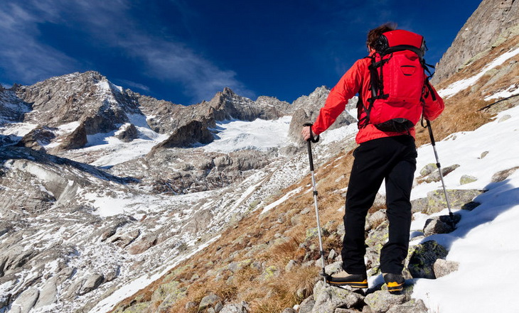 Hiker climbing the highest mountains on the Earth