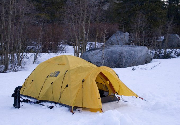 camping in tent in snowy conditions