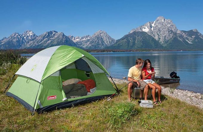 couple near lake with cheap tent