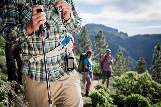 hiker wearing gps device on belt