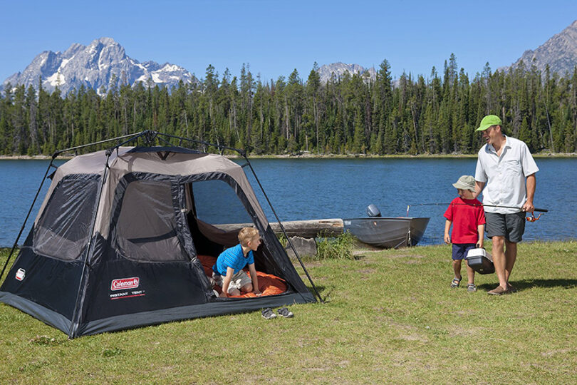 family camping in 4 person tent near the lake