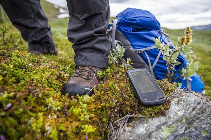 gps device next to hikers foot