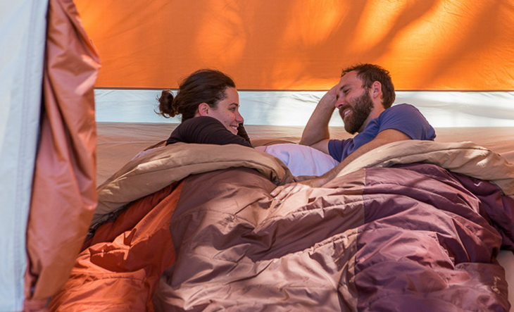 A couple sharing The North Face Dolomite 3S sleeping bag in a tent