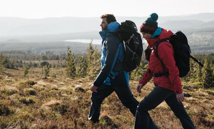 A couple wearing the Berghaus Island Peak jackets
