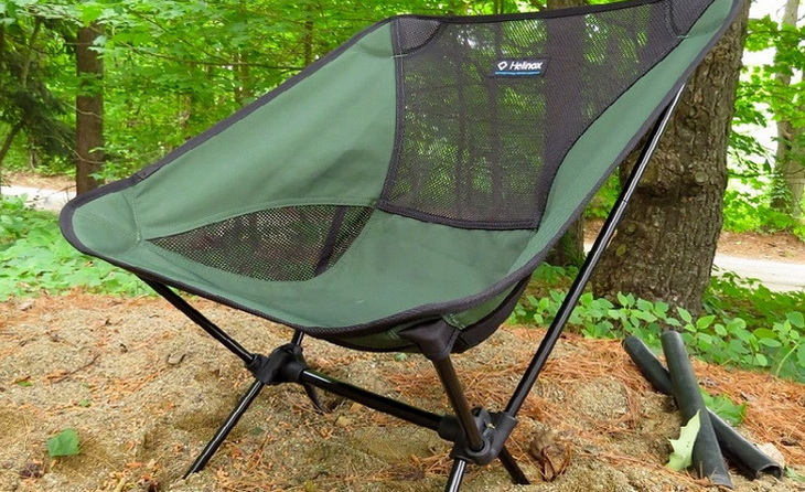 Front image of a backpacking chair in the forest