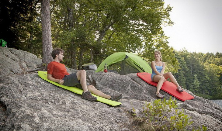 A couple relaxing on sleeping pads