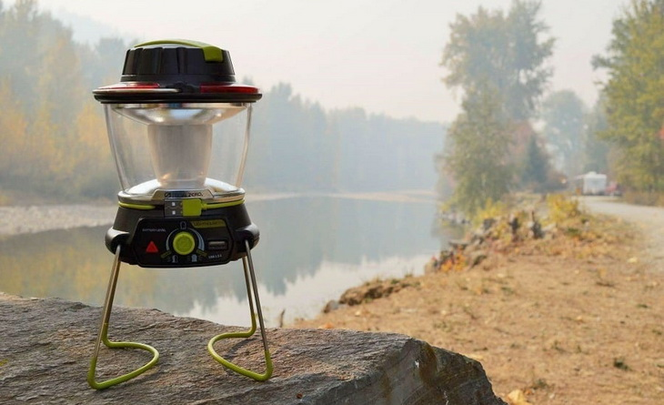 Image of a camping lantern sitting on a rock