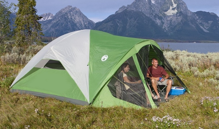 Two adults in a tent in summer time