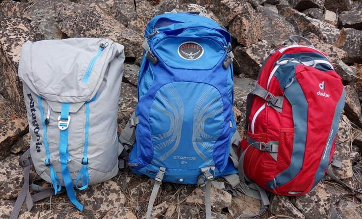 Three different types of daypacks on the ground