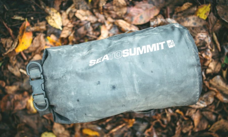 Sea to Summit dry bag on the ground in a forest