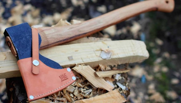 Cutting wood with a hatchet-for-camping