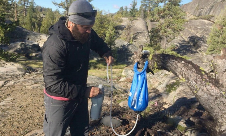 A man using a Gravity Water Filter