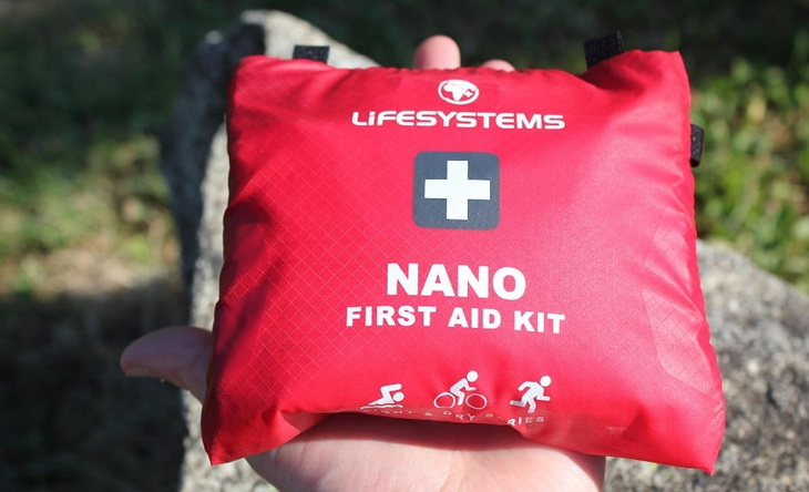 A person holding a Nano first aid kit