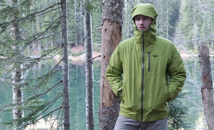 Man in a forest wearing a rain jacket