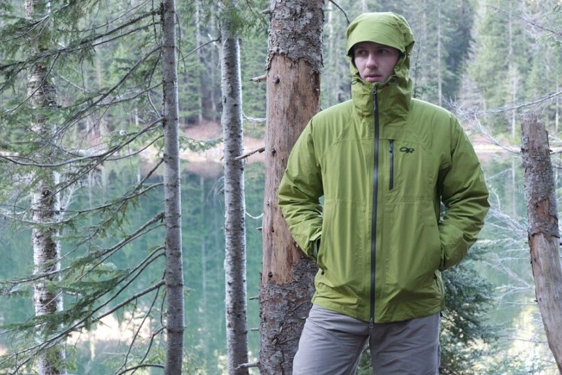 man wearing Rain jacket in the woods