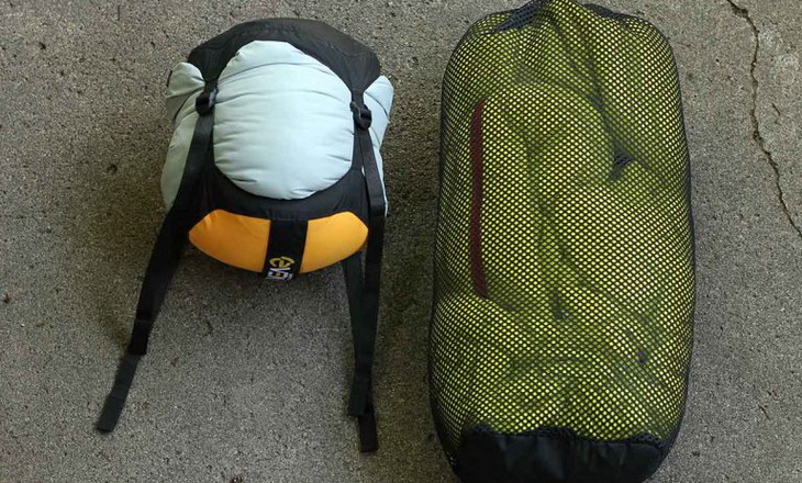 Two sleeping bags side by side on the floor