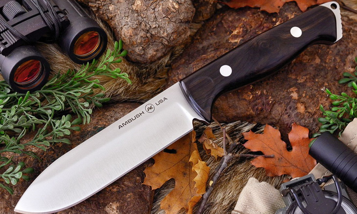 Image of a camping knife on the ground