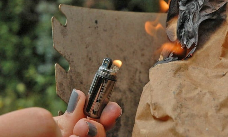 Woman holding a lighter for survival
