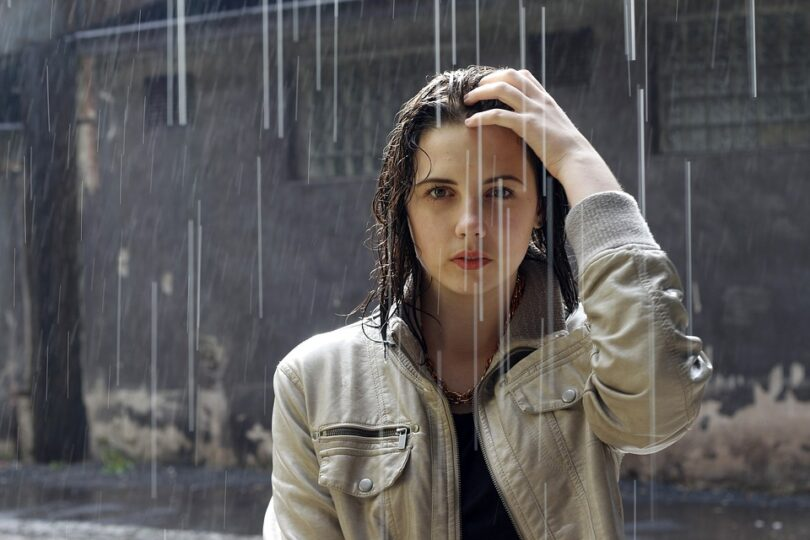woman wearing a jacket standing in the rain