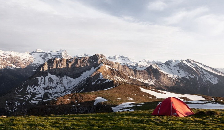 Image of a camping tent in a mountains landscape