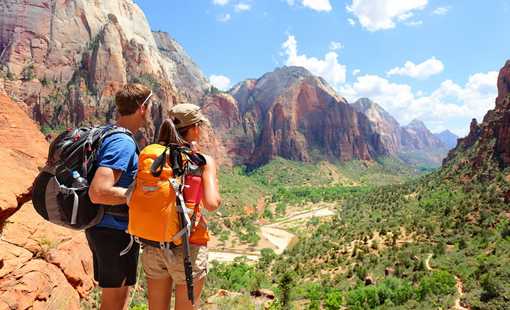 Two hikers looking at the landscape in front of them