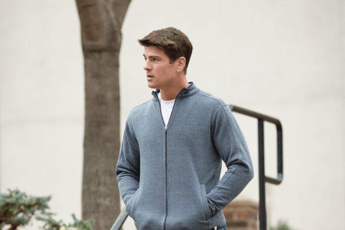 man wering fleece jacket with zippers