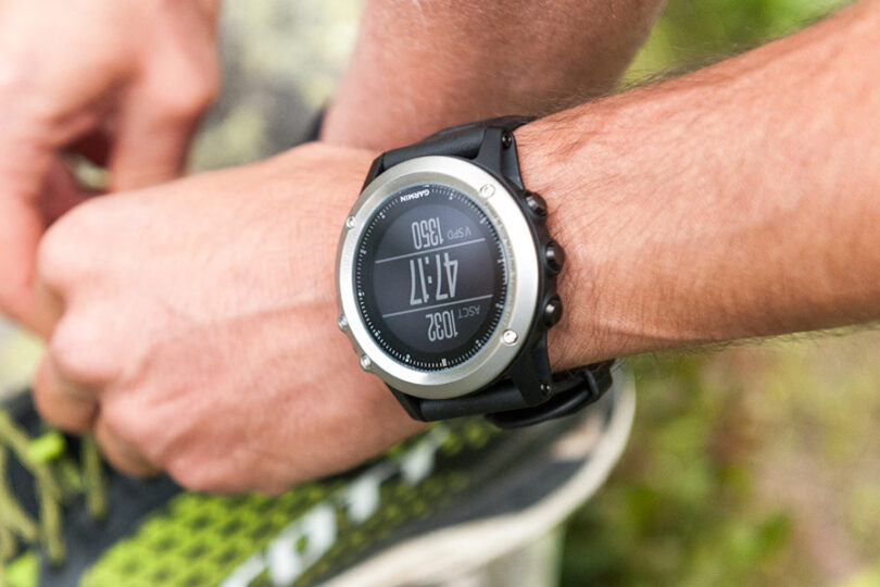 runner wearing garmin watch