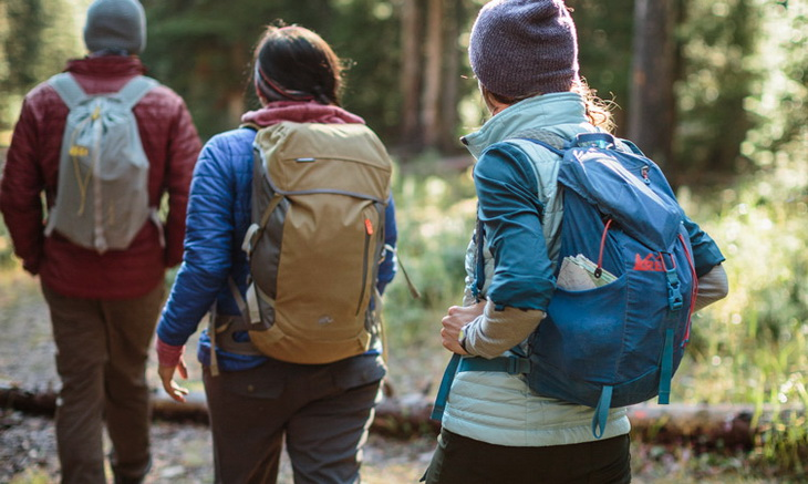 three hikers on the trail with their daypacks on
