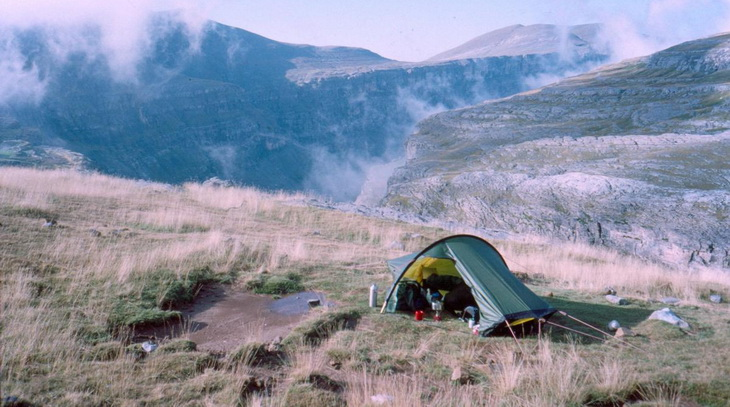 A solo tent in a mountain landscape