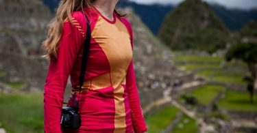 A woman wearing Helly Hansen's HH Dry Revolution base layer while hiking