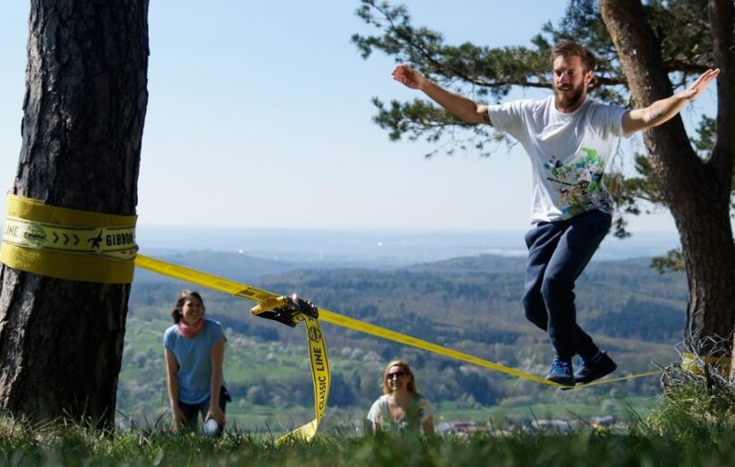 man walking on a slackline
