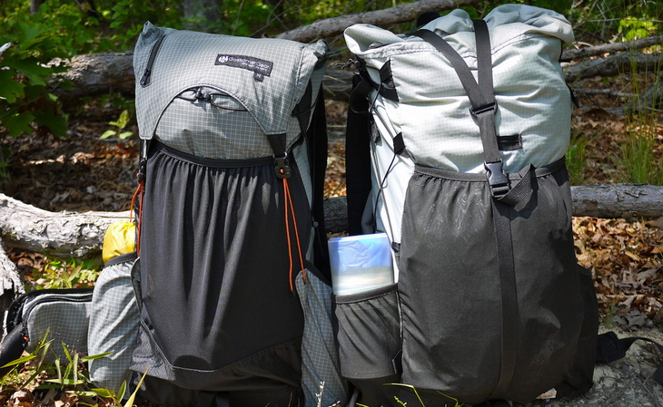 Image of two ultralight backpacks on the groud in the forest