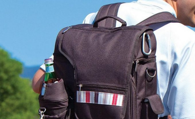 A man wearing a backpakc-cooler-with-side-pocket