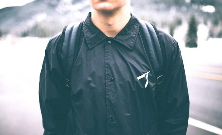 A man wearing a windbreaker jacket