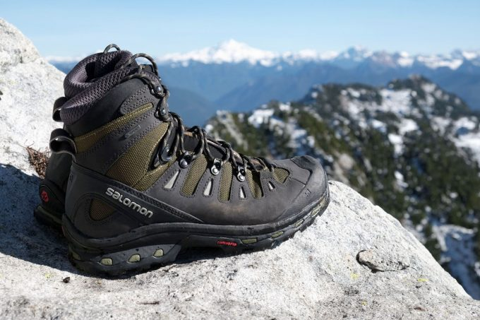 A pair of Hiking Boots and a moutain landscape