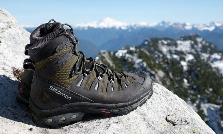 A pair of Hiking Boots and a beautiful landscape in the background