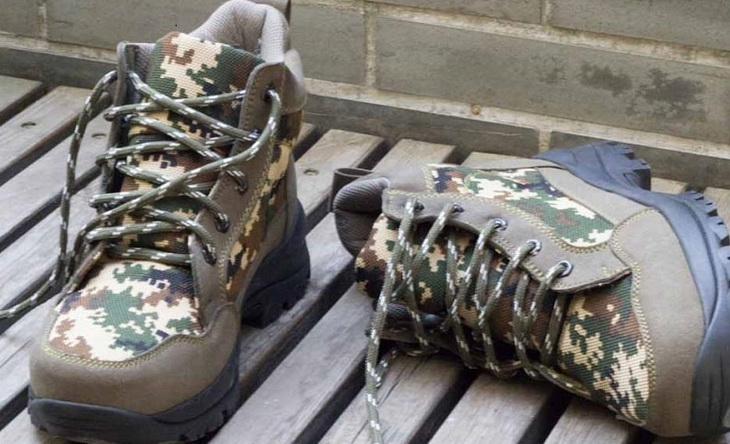 A pair of hiking boots for mens