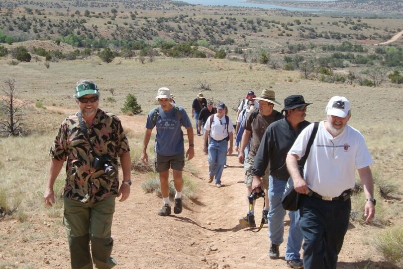 group of hikers wearing hats