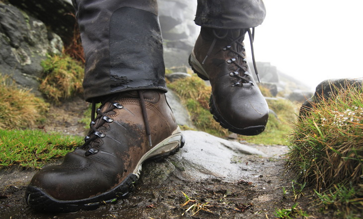 A man walking in a pair of winter hiking boots