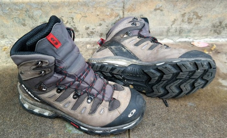 Men hiking boots laying down