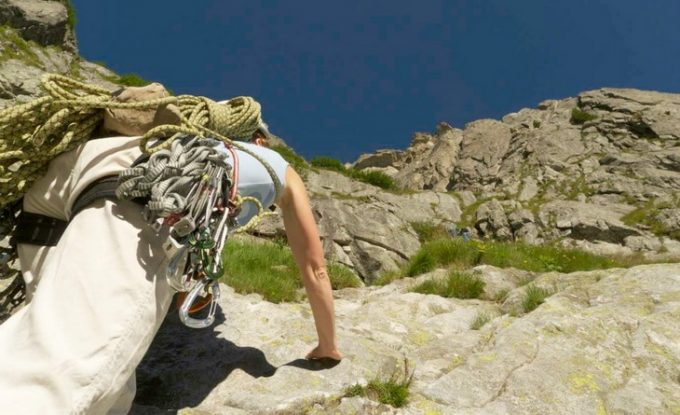 Image of a person climbing the moutain