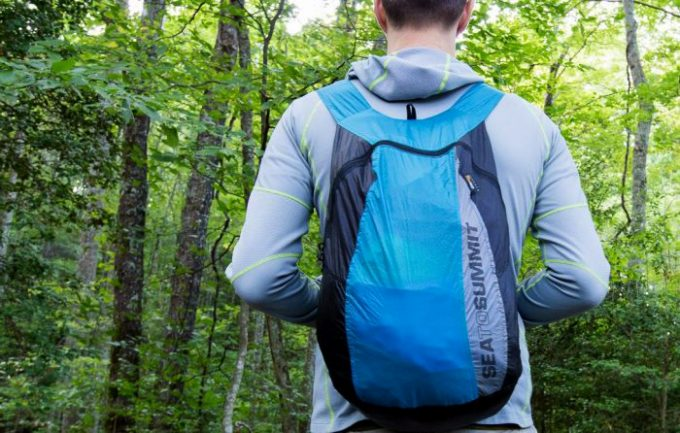 Packable daypack on the back of a hiker